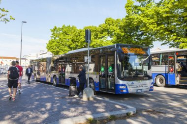 Verona, Italy, on April 27, 2019. City bus station. The shuttle to the airport waits for passengers