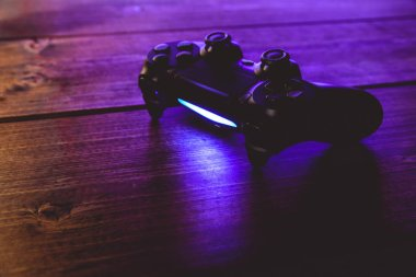 Video game controller at night with lights
