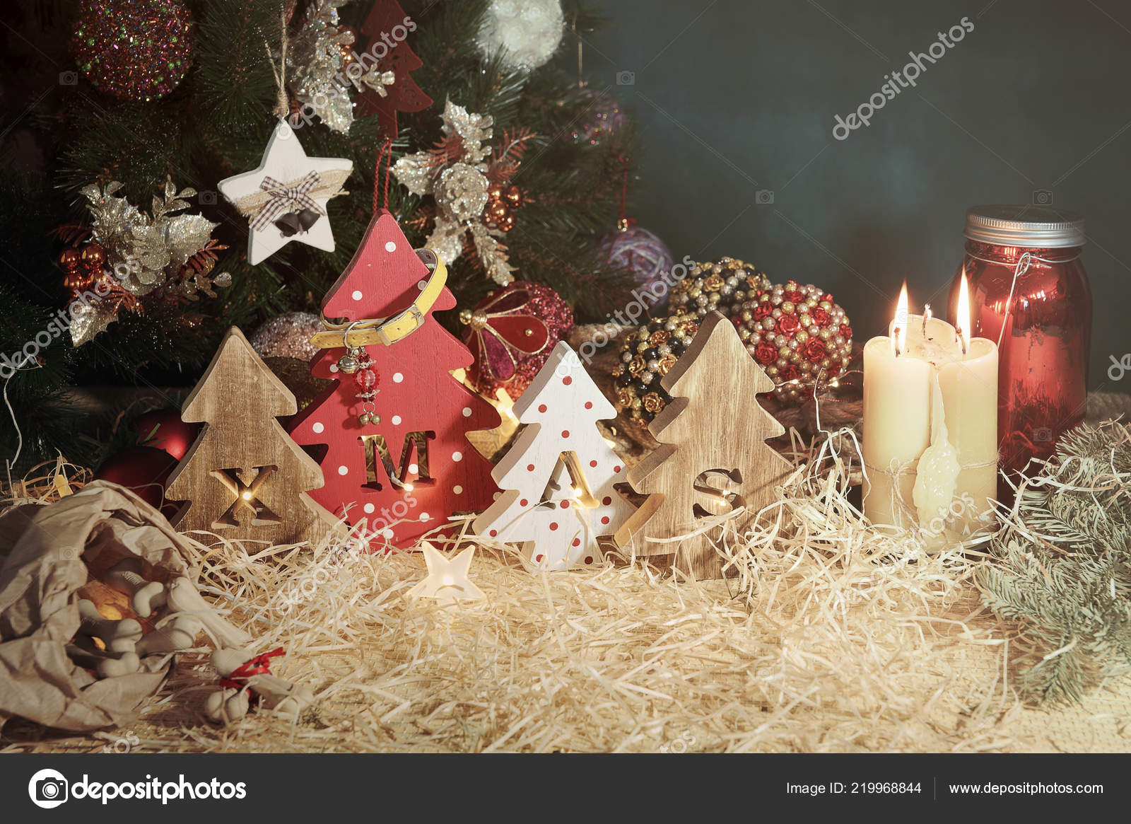 Four Decorative Wooden Christmas Trees With Carved Letters Xmas And