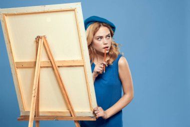 Woman artist blue take easel hobby drawing Creative blue background