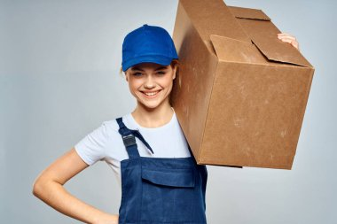 Woman in working uniform box packing service lifestyle