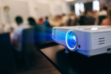 Close view of projector showing film to audience