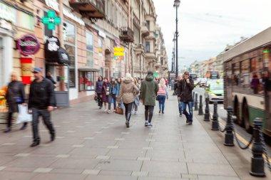 Saint Petersburg, Russia, October 20, 2017: Crowd of pedestrians walk down the city street. Zoom effect