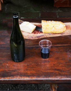 table with sweet cheese platter and wine drink