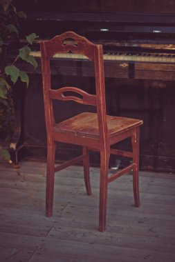 Wooden old chair at the piano.