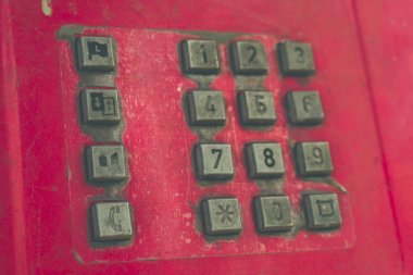 Old street red push-button telephone