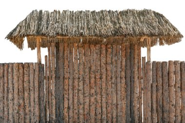 Round timber wooden log fence isolated on white. Hay roof or awning over entrance gate