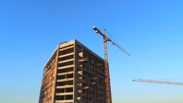 High tower building construction site. Big industrial crane. Aerial drone view. Metropolis city development