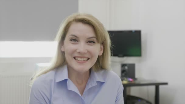 Successful businesswoman at the office expressing excitement enjoying receiving good news about her goals business success and achievement concept
