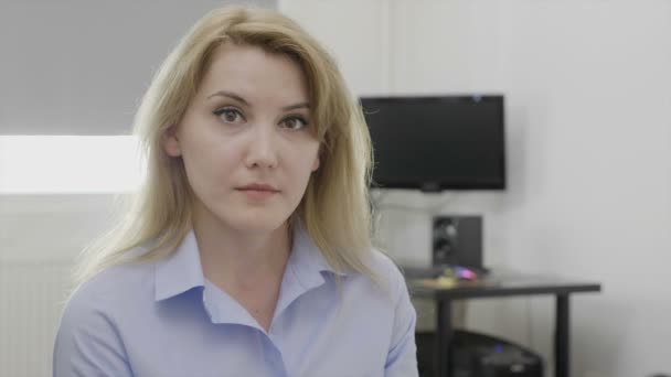 Beautiful young female employee expressing surprise and jaw dropped shocked reaction