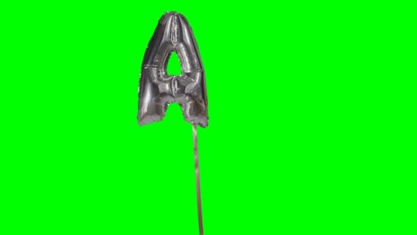 Písmeno A abeceda helium stříbrné bubliny plovoucí na zelené obrazovce