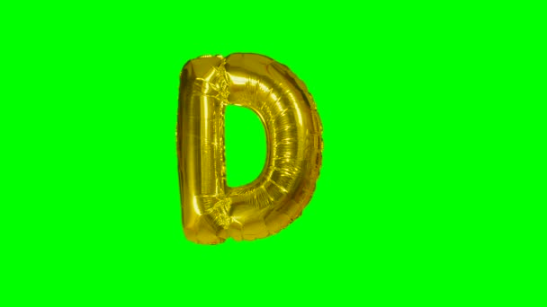Big Letter D from alphabet helium gold balloon floating on green screen