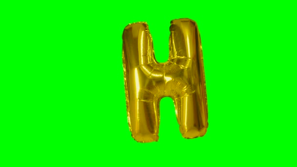 Big Letter H from alphabet helium gold balloon floating on green screen