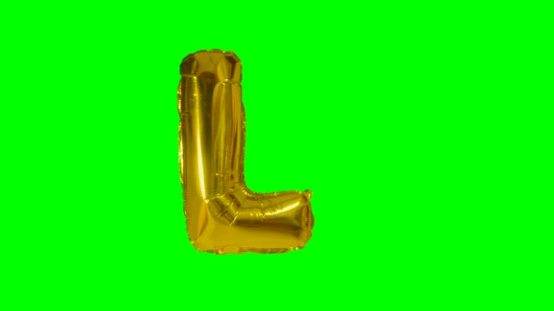 Big Letter L from alphabet helium gold balloon floating on green screen