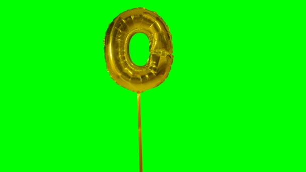 Letter O from alphabet helium gold balloon floating on green screen