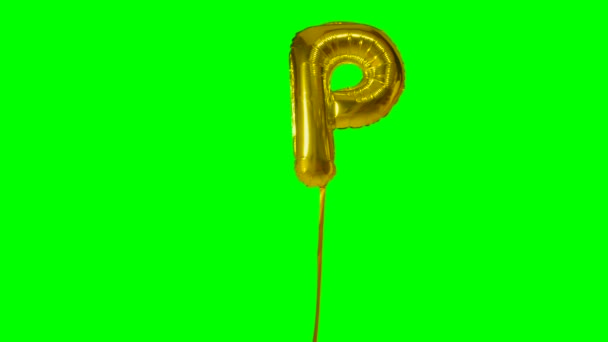 Letter P from alphabet helium gold balloon floating on green screen