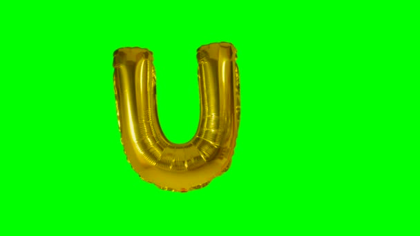 Big Letter U from alphabet helium gold balloon floating on green screen