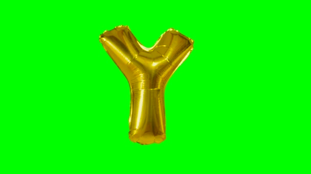 Big Letter Y from alphabet helium gold balloon floating on green screen