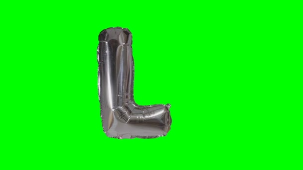 Big Letter L from alphabet helium silver balloon floating on green screen