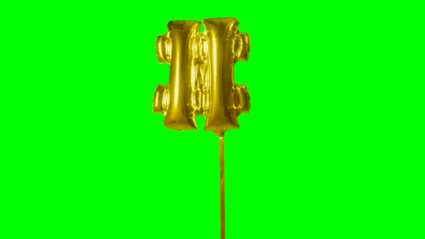 Sign symbol number hash pound and from alphabet helium gold balloon floating on green screen