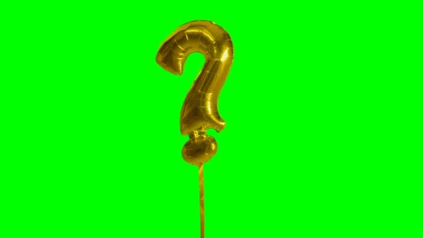 Znaménko symbol otazník abeceda helium zlato bubliny plovoucí na zelené obrazovce