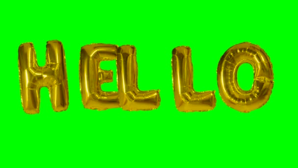 Word hello from helium gold balloon letters floating on green screen