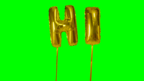 Word hi from helium golden balloon letters floating on green screen
