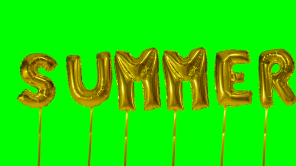 Word summer from helium golden balloon letters floating on green screen