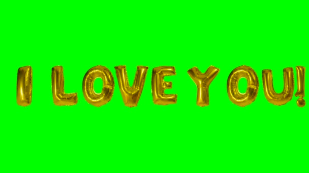 Word I love you from helium gold balloon letters floating on green screen