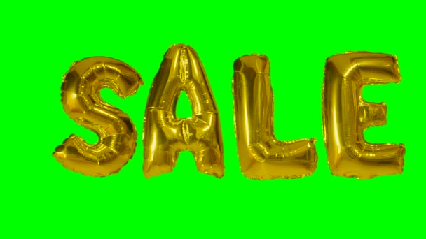 Word sale from helium gold balloon letters floating on green screen
