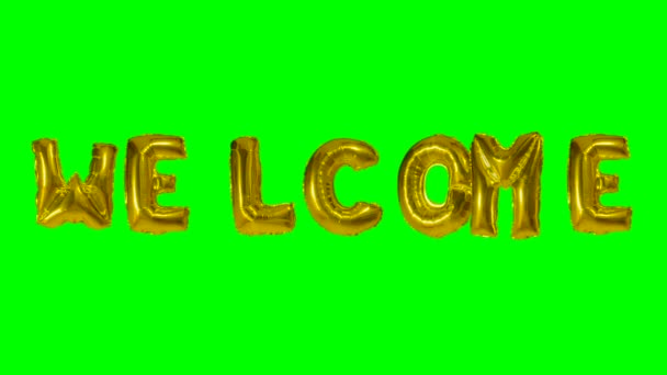 Word welcome from helium gold balloon letters floating on green screen