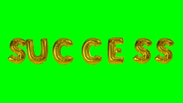 Slovo úspěch z helia zlatá bublina dopisy plovoucí na zelené obrazovce