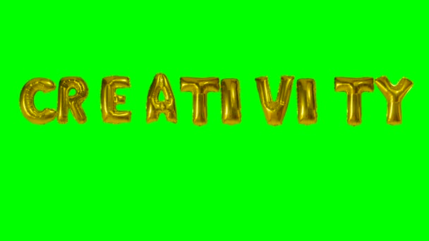 Word creativity from helium gold balloon letters floating on green screen