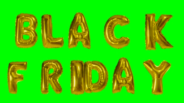 Word black friday from helium gold balloon letters floating on green screen