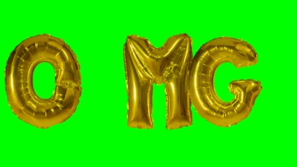 Slovo Omg od helium zlatá bublina dopisy plovoucí na zelené obrazovce