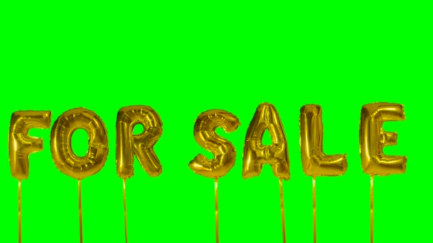 Word for sale from helium golden balloon letters floating on green screen