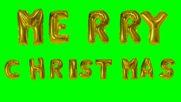Word merry Christmas greeting from helium golden balloon letters floating on green screen