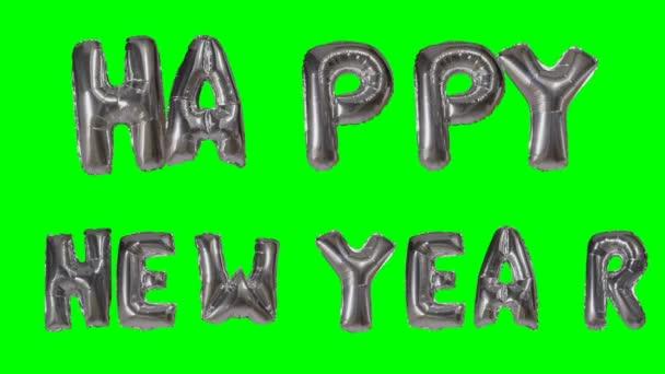 Slovo šťastný nový rok pozdrav z helia stříbrná bublina dopisy plovoucí na zelené obrazovce