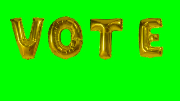 Word vote from helium gold balloon letters floating on green screen