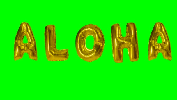 Word aloha from helium gold balloon letters floating on green screen