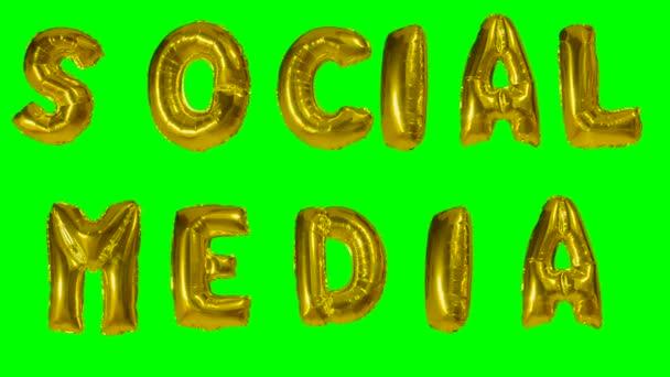 Slovo sociální média z helia zlatá bublina dopisy plovoucí na zelené obrazovce