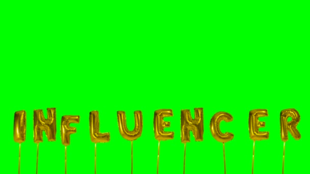 Word Influencer from helium golden balloon letters floating on green screen