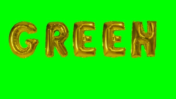 Slovo green z helia zlatá bublina dopisy plovoucí na zelené obrazovce