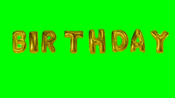 Word birthday from helium gold balloon letters floating on green screen