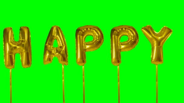 Word happy from helium golden balloon letters floating on green screen
