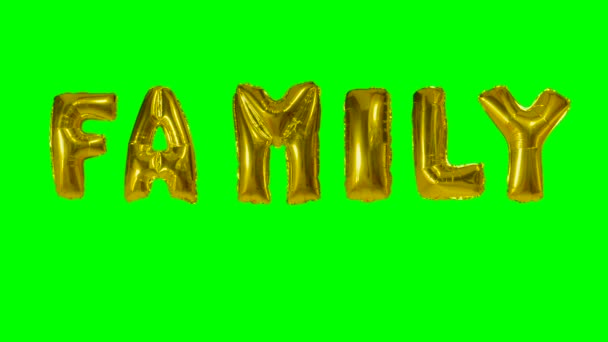 Word family from helium gold balloon letters floating on green screen