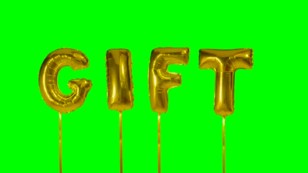 Word gift from helium golden balloon letters floating on green screen