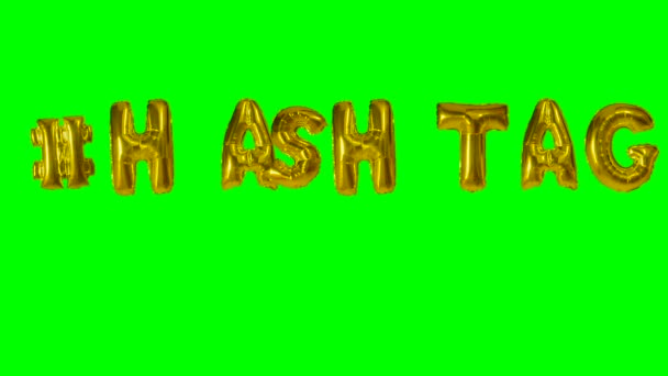 Word hashtag from helium gold balloon letters floating on green screen