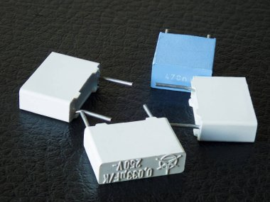 Electronic capacitors in black background