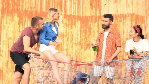 Friends spending time together. Standing with supermarket carts, joking, laughing and talking.
